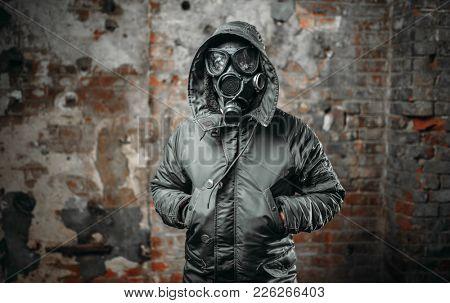 Stalker in gas mask survivor man after nuclear war