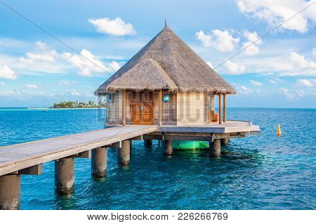 Rangali, Maldives Island - 16 June 2017: Beautiful Tropical Sunset Landscape With Wooden Villas Over