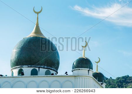 Muslim mosque on blue sky background.Beautiful muslim temple.Vintage tone.