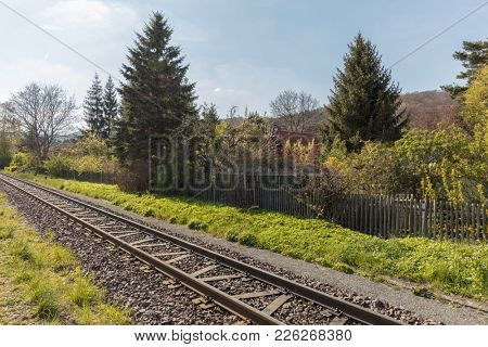 Rails for railway in the track beside garden in spring in germany