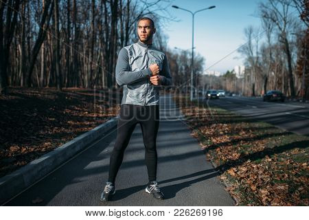Male jogger in motion on workout outdoors