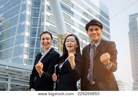 Yeah, Finally We Did It, Group Of Business People In Suit Screaming Showing Their Strong Hands Toget