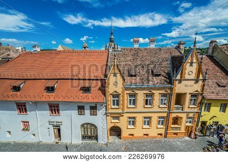 Sighisoara, Romania - July 4, 2016: View On Town Houses On Scolii Street On The Old Town Of Sighisoa