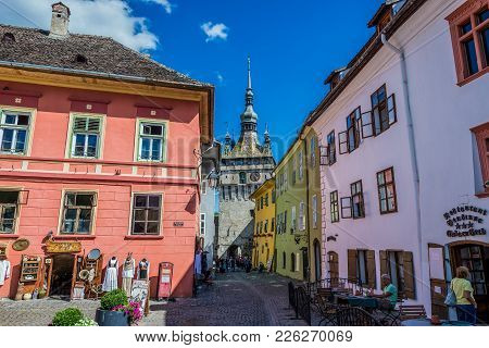 Sighisoara, Romania - July 4, 2016: Town Houses On A Market Square Of Old Town In Sighisoara Tourist