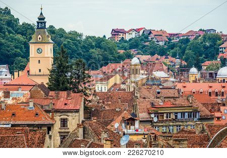 Brasov, Romania - July 5, 2016: View The Roofs Of Old Town Buildings In Brasov With Council House To