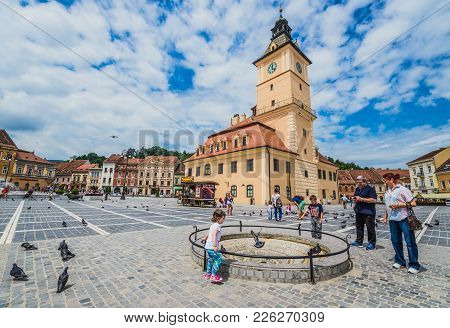 Brasov, Romania - July 5, 2016: Council House Building Located In The Middle Of Main Square Of Old T
