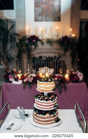 Three-tiered Naked Wedding Cake With Blueberries, Raspberries And Berries, Two Heart Form Plates On