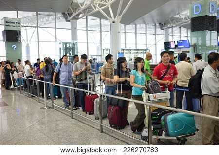 Hanoi, Vietnam - Apr 29, 2016: Queue Of Asian People In Line Waiting At Boarding Gate In Noi Bai Air