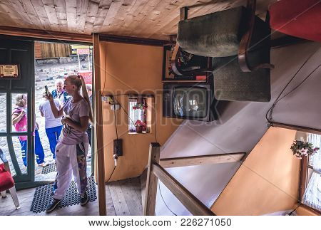 Szymbark, Poland - September 10, 2016: Tourists Visits Wooden Upside Down House In Open Air Museum I