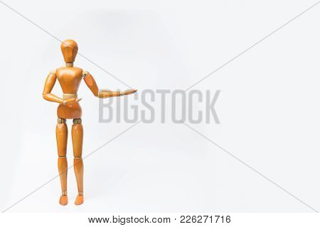 Wooden figure pose raising arm hand to introduce product for business.white isolated background