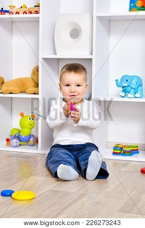 Cute Happy Child Playing  In The Playroom