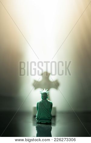 Back View Of The Statue Of Liberty Bow Down And Praying To God And Jesus Christ.god Bless America An