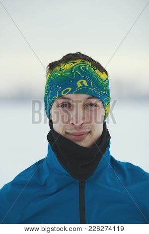Portrait Of A Smiling Young Male Athlete In Winter, Sport And Leisure Concept