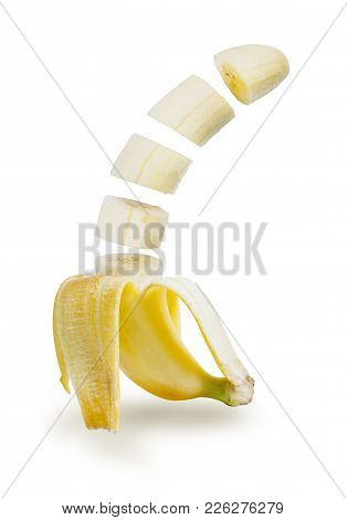 Tropical Fruit, Banana Peeled And Sliced On Isolated On White Background, File Contains A Clipping P