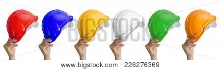 Collection Of Hand Holding Multicolored Safety Helmets On White Background, Head Protection. File Co