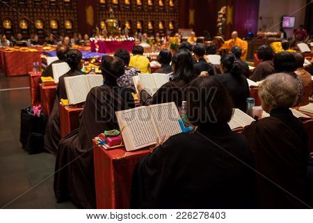 Singapore - May 2, 2016: Monks And Buddhists Praying At Buddha Tooth Relic Temple And Museum. The Ta