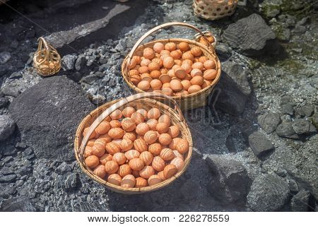 Big Baskets Of Many Eggs Boiled Under Clear Hot Mineral Water Pond Of Hot Spring.