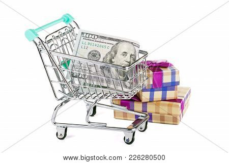 A Supermarket Trolley With Dollars And Purchases. Concept - Sales And Discounts.
