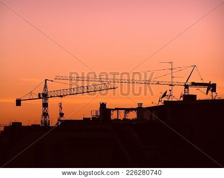 Silouette Of An Urban Background. Red Sunset Over The City