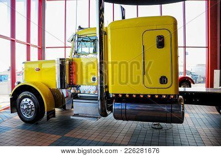 Omaha, Nebraska - February 24, 2010 - Yellow Peterbuild 379 Semi Truck Displayed At Iowa 80 Trucksto