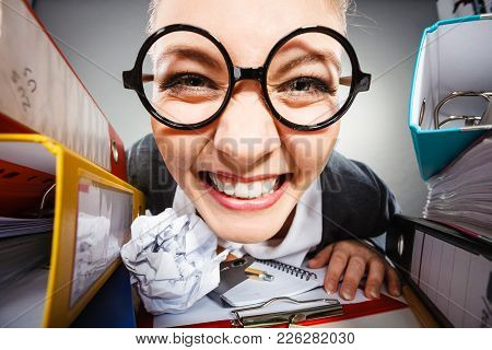 Facial Expressions During Work. Crazy Satisfied Accountant Businesswoman Surrounded By Documents And