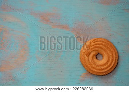 One Round Butter Cookies/biscuits On Wooden Teal Green Rustic Background With Space For Text, Flat L