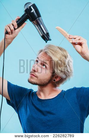 Style And Fashion. Young Trendy Male Hairstylist Barber With New Idea Of Look Changing. Blonde Man H