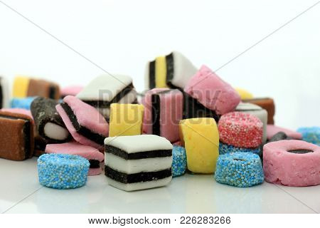Stacked Liquorice All Sorts In Different Shapes, Colors And Sizes