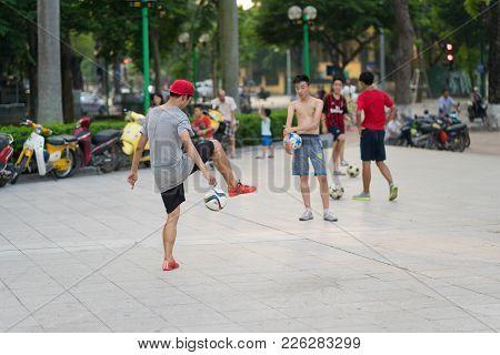 Hanoi, Vietnam - July 10, 2016: Children Training Football At Lenin Park Or Thong Nhat Park On Dien