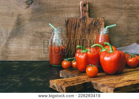 Fresh Vegetable Red Peppers And Cherry Tomatoes, Tomato Juice On Wooden Table, Rustic Style. The Con