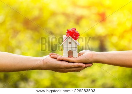 The Buying A New Real Estate As A Gift To Family Or The One Loved Concept, A Man And A Woman Hand Ho