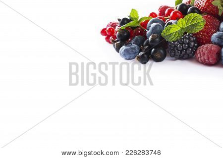 Mix Berries On A White Background. Ripe Blueberries, Blackberries, Currants And Strawberries. Variou
