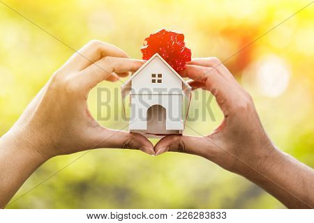 The Buying A New Real Estate As A Gift To Family Or The One Loved Concept, A Woman Hand Holding A Ho