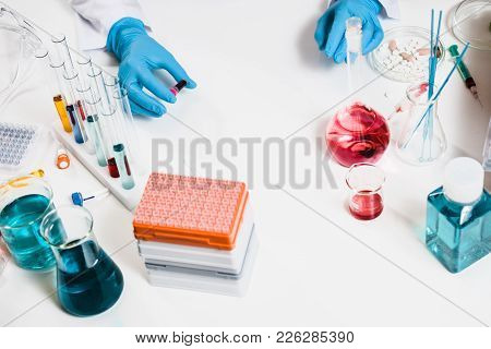 Scientists Holds Blood Sample In Hand In Laboratory. Drug Discovery, Pharmacology And Biotechnology