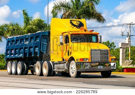 Quintana Roo, Mexico - May 16, 2017: Yellow Dump Truck International 9400 At The Interurban Road.