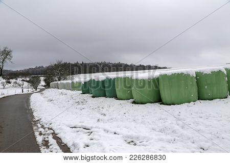 Winter / Winter Landscape / Rolls with fodder in winter