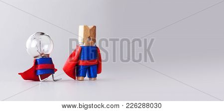 Success Management Creative Concept. Super Heroes Team Clothespin And Light Bulb, Funny Toy Characte
