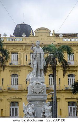 Havana Cuba - 26 January 2018:  Statue Of Jose Marti In Parque Central Havana With Hotel Inglaterra