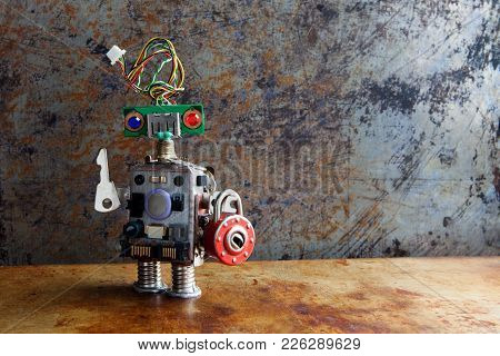 Friendly Robot Toy With Key Padlock On Vintage Background