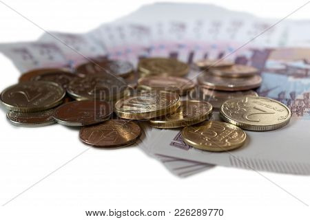 Rubles Coins Against Background Of 500 Rubles Banknotes Fan Close Up