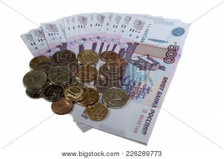 Rubles Coins Against Background Of 500 Rubles Banknotes Fan