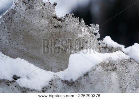 Snow Winter Background, Close-up Of Frosted Ice Lump On A Snowing Day With Copy Space.