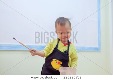 Cute Little Asian 18 Months / 1 Year Old Toddler Baby Boy Child Painting With Brush And Watercolors