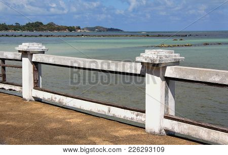The Sea And Promenade With White Handrail.
