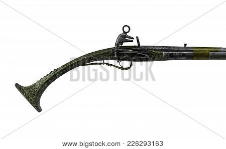Handle Of An Old Musket Isolated On A White Background.