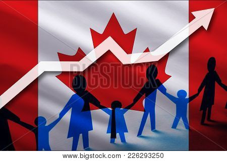 Canada Flag On A Background Of A Growing Arrow Up And People With Children Holding Hands. Demographi