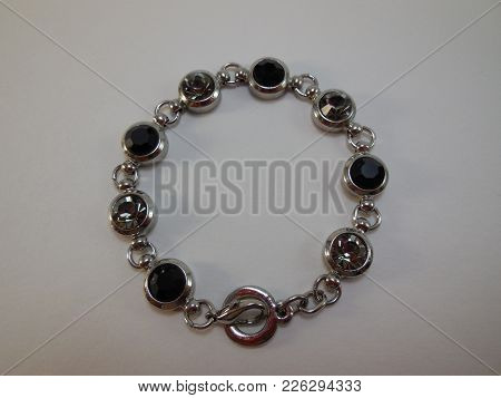 Bracelet Made Of White Metal With Large Transparent Stones And Stones Of Black Color