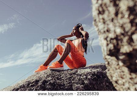 Female Taking Break After Fitness Training