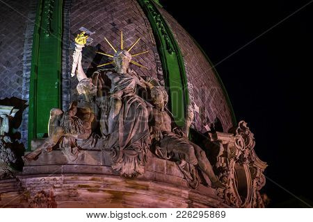 The World's Only Sitting Statue Of Liberty At Night Timeю Lviv Woman Liberty Gently Embraces Two Men