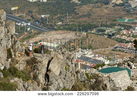 Unidentified Tourists On The Peak Of Mount Calamorro, The Highest Point Of Benalmadena, Looking To T